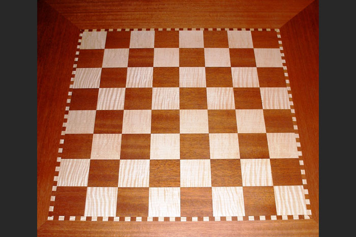 MAHOGANY AND FIGURED MAPLE CHESS TABLE